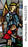 Stained glass window of guardian angel with little girl in red dress picking flowers - stock photo