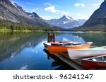 Canoes By Lake Mc Donald In...
