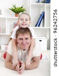 portrait of happy family lying... | Shutterstock . vector #96242756