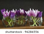 Pink And Purple Tulips In A...