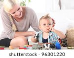 mother watching son playing...   Shutterstock . vector #96301220