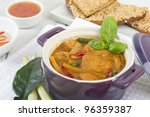Kaeng Phet (Thai Red Chicken Curry)  - Side dish of prawn toast and chili sauce - stock photo