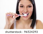 Young Girl Brushing Her Teeth...
