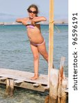 Girl on the wooden pier - stock photo