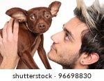 young man posing with pinscher... | Shutterstock . vector #96698830