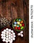 Easter eggs and  natural wooden country table, background and texture - stock photo