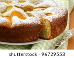 homemade ??pie with peaches, sprinkled with  powdered sugar - stock photo