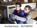 Small photo of young apprentice in industry sector with tutor