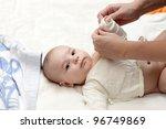 a mother dressing her serious... | Shutterstock . vector #96749869