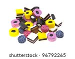 Liquorice allsort sweets in colourful abstract stack design isolated over white background. - stock photo