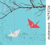 Two Paper Cranes Hanging On...