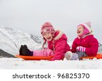 two laughing kids sledding with ... | Shutterstock . vector #96825370