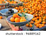 Fresh mandarin citrus fruits on a market stand - stock photo
