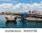 Queen Emma Bridge across the harbor of Willemstad, Curacao - stock photo