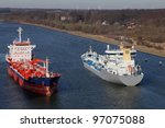 tanker and freighter on Kiel Canal - stock photo