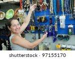 Mature Woman  Chooses Souvenir...