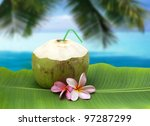 coconut beverage straw cocktail on tender banana leaf isolated - stock photo