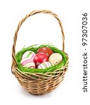 Easter eggs in the basket on white background