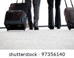 Business Travellers Walking In...