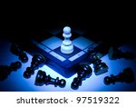 Chess board and pawns. A dark blue art background. - stock photo