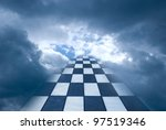 Chess board on a background of the dark blue sky. - stock photo