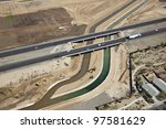 Construction to alter direction of irrigation canal - stock photo