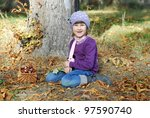 little girl collects chestnuts   Shutterstock . vector #97590740