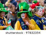 LIMERICK, IRELAND - MARCH 17: Unidentified children in Irish hat participate in a parade for St. Patrick's Day. It's a traditional Irish holiday celebration. March 17, 2012 in Limerick, Ireland. - stock photo