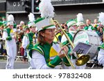 LIMERICK, IRELAND - MARCH 17: Unidentified people participate in a parade for St. Patrick's Day. It's a traditional Irish holiday celebration. March 17, 2012 in Limerick, Ireland. - stock photo