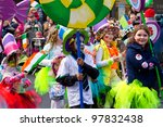 LIMERICK, IRELAND - MARCH 17: Unidentified children participate in a parade for St. Patrick's Day. It's a traditional Irish holiday celebration. March 17, 2012 in Limerick, Ireland. - stock photo