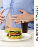 fat stomach with burger and cola | Shutterstock . vector #97913924