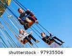 Teenage Girls On A Chain Swing...