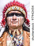 Small photo of Portrait of american indian chief in national dress