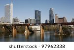 AUSTIN, TEXAS - MAR 9: SXSW 2012 South by Southwest 2012 Annual music, film, and interactive conference and festival on March 9, 2012 in Austin, Texas. Festival is held from March 9-18. Austin Skyline, Colorado River and railway bridge - stock photo