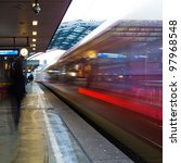 leaving train at dawn in motion blur showing light trails - stock photo