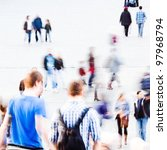 abstract picture of commuting people with motion blur - stock photo