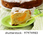 homemade pie with peaches, sprinkled with  powdered sugar - stock photo