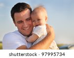 Happy Young Father With Little...