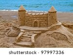 Sand Castle On The Beach Of...
