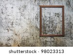 blank photo frame on old wall   Shutterstock . vector #98023313