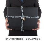 Businessman holding laptop with chain and lock. Isolated on white - stock photo