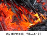 Burning paper waste - close up with shallow DOF. Enviromental concept. - stock photo