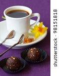 Cup of coffee and homemade chocolate truffle. - stock photo