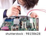 Computer engineer working on a old motherboard - stock photo