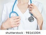 Unrecognizable young woman doctor holding stethoscope, front view - stock photo