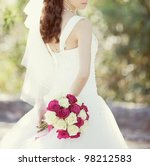 Stock photo pink and white wedding bouquet of roses in the hands of the bride 98212583