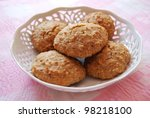 Homemade almonds cookies in white porcelain tray on pink background - stock photo