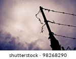 A Silhouetted Metal Fence Post...