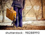 lonely girl with suitcase... | Shutterstock . vector #98288993