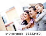 beautiful family outside their... | Shutterstock . vector #98332460